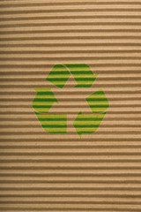 brown cardboard texture and recycling sign