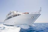Large motor yacht under way at sea poster