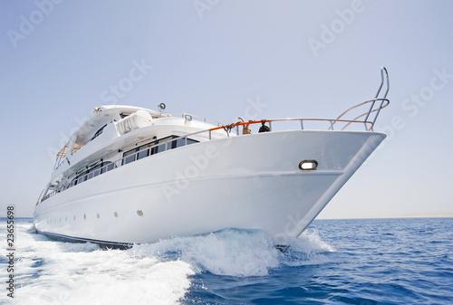 Large motor yacht under way at sea - 23655698