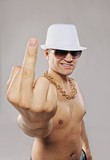 Stylish man in white hat showing middle finger