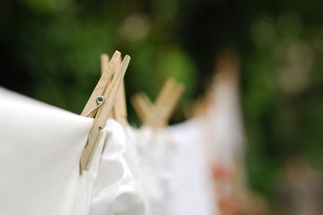 Wooden Pegs on Clothesline