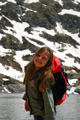 Little girl happy and smiling doing walk in Hight mountains