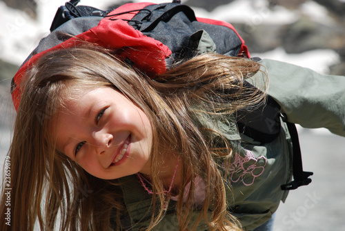 Little girl happy and smiling in Hight mountains
