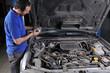 Auto mechanic working on car engine - a series of MECHANIC