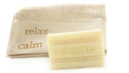 Bar of Oatmeal soap with towel on white
