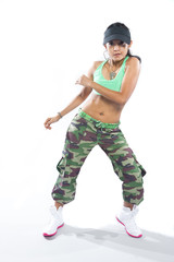 Beautiful woman hip hop dancer striking a pose