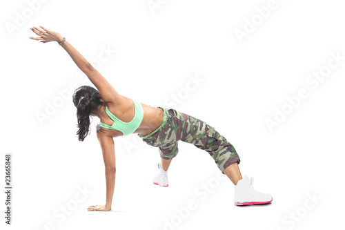 Beautiful female hip hop dancer striking a dance pose.