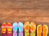 Brightly colored flip-flops on wood - Fine Art prints