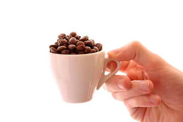 Small white cup of coffee with coffee grain in hand on white bac