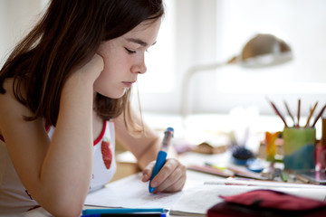 Girl doing homework at home