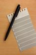 A notepad sheet whith a pen