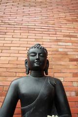 A gray stone  sculpture of a Buddha in Sri Lanka