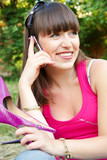 glad girl talking on the phone on nature poster