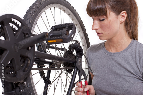 fixing gear on bicycle with plier