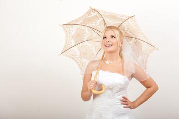 pretty bride with wedding umbrella