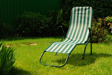 Chaise lounge on a grass