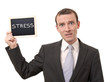 Man holding a blackboard with stress written