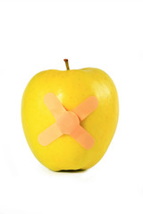 Yellow apple with strapping tape isolated