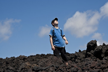 boy on walking trail thru volcanic area in Lanzarote