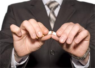 No smoking. A hand crushing cigarettes