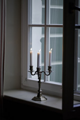 Candlestick holder by the window