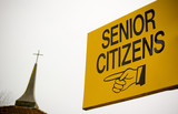 Sign for Senior Citizens seems to point to God poster