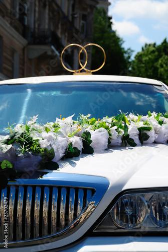 White wedding limousine with flowers
