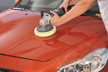 Car care with power buffer machine at service station.