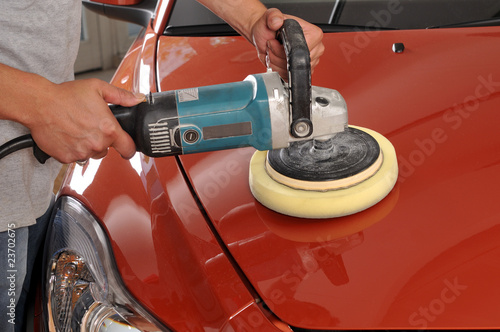 canvas print picture Car care with power buffer machine at service station