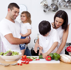 Loving young family cooking together