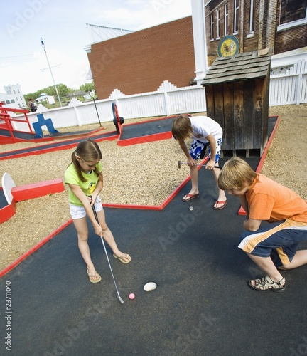 Children Playing Mini Golf