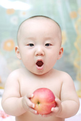 cute baby eat apple