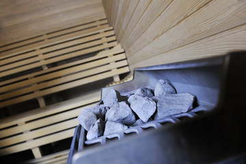 hot stones and splashing water in sauna