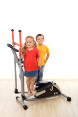 Two kids on a fitness equipment