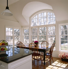 Kitchen Table and Chairs Surrounded by Windows