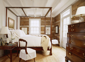 Exposed Cut Log Walls in Traditional Bedroom