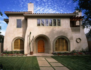 Contemporary Stucco House with Curved Walls