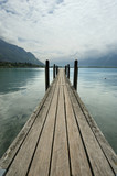 The wooden pier for boats and yachts poster