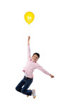 Child flying with yellow balloon