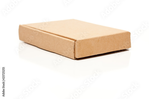 Closed Thin Cardboard Box on White