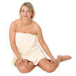 woman with towel sitting on floor on white background