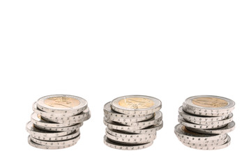 Three columns of two-euro coins isolated on white background