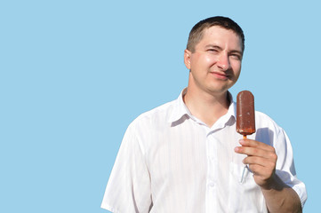 A young man eating ice cream