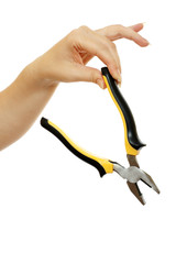 pliers in a beautiful female hand