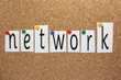 Network in cut out letters on a cork board