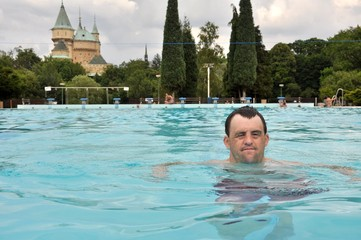 down syndrome man in pool