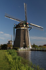 Windmills on dutch countryside