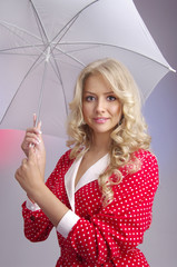 Blond woman with umbrella