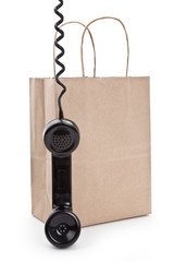 Brown paper shopping bag and telephone