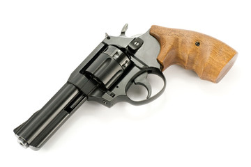 revolver gun with wooden handle , over white background